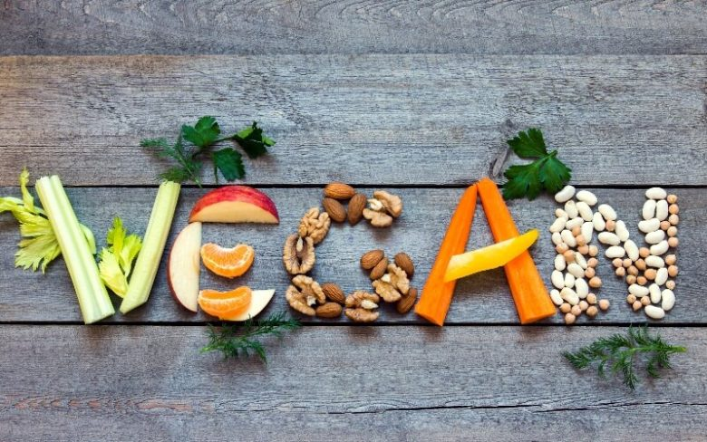 Vegan spelled out in vegetables