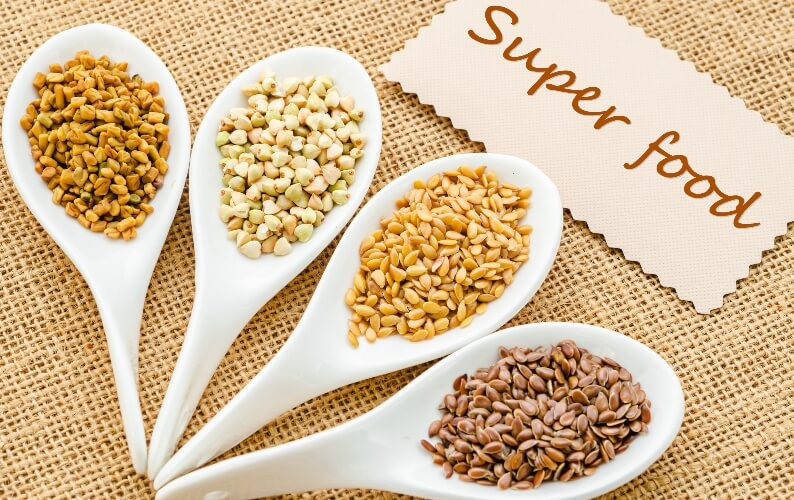 Ancient grains on spoons with a note saying super food