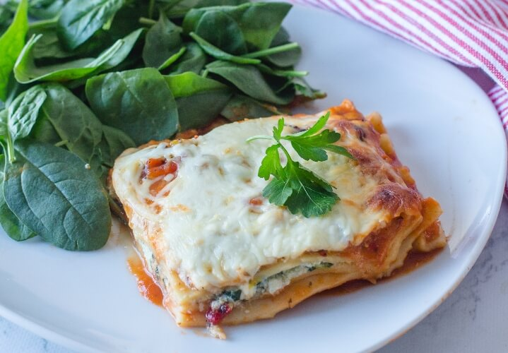 Baked vegan lasagna with melted cheese.