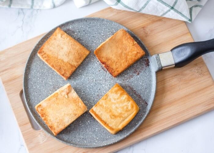 Vegan breakfast sandwich - fry the tofu until golden brown