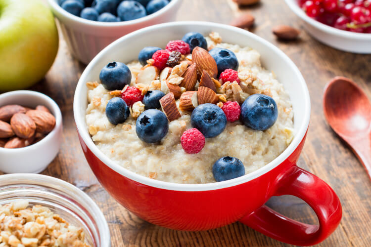 Oatmeal vegan breakfast with nuts and berries