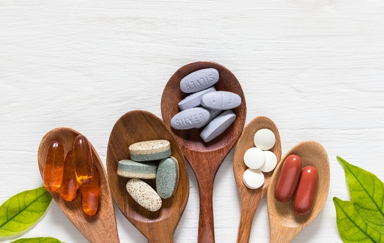 Plant-based supplements on spoons