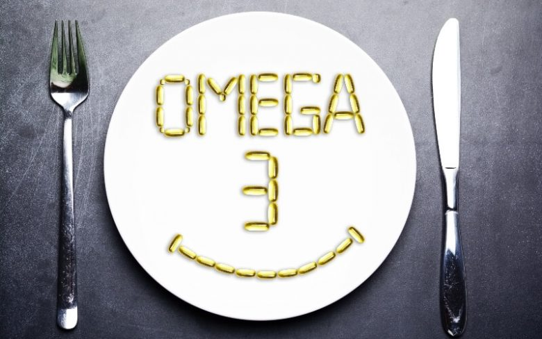 Smiley face made from vegan omega-3 supplements