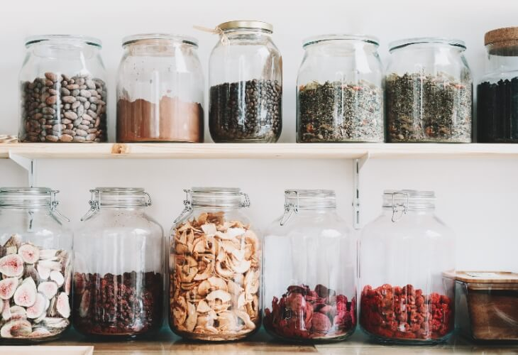 Dried nuts and fruit in glass jars