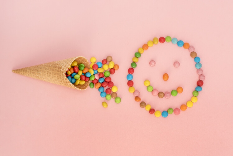 Vegan-friendly Skittles and Smarties in a smiley face