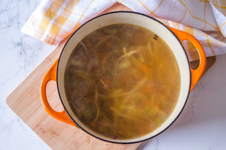 Broth in vegan chicken noodle soup